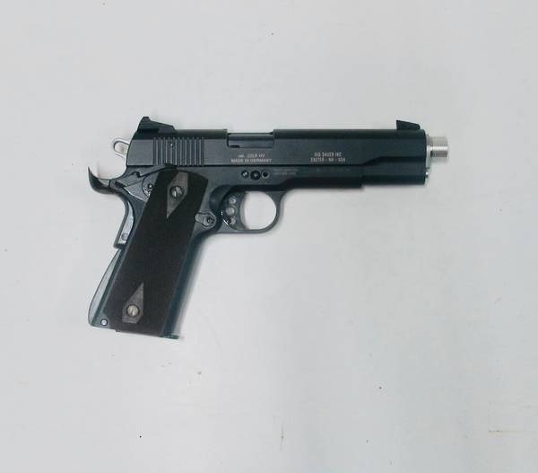 Sig 1911 22 lr As new condition with threaded barrel, silencer  after market barrel bus. Both magazines have after market follo